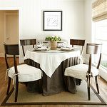 dining rooms - beadboard round dining table seagrass rug white brown linen tablecloth mirrored chest cabinet bamboo roman shade Klismos Dining Chair