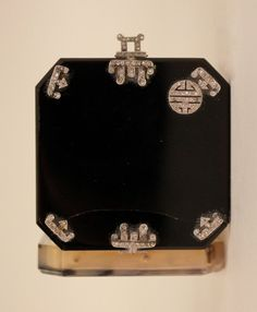 Art Deco Diamond & Onyx Vanity Case By LACLOCHE Freres, Paris, Circa 1925.The hinged square box with diamond decoration on onyx at top. Bottom appears to be agate. Interior with lipstick holder and small compartment. (hva)