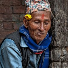 Gentleman with flower in Nepal....Photo by Piet Flour