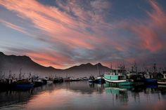 Hout Bay harbour at sunrise. BelAfrique - your personal travel planner - www.BelAfrique.com