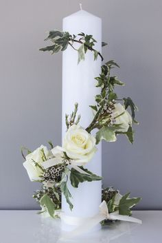 A candle delicately wrapped with roses and a loose bow. Simple Rose, 50th Wedding Anniversary, Concrete Planters, Corsages, Simple Weddings, Weeding, Altar, Amelia, Flower Arrangements