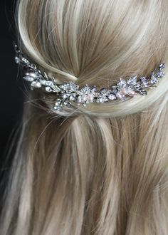 Inspired by our Ophelia, Camillia and Leona bridal headpieces, we created this crystal wedding comb, resembling a vine and featuring pearl floral accents.