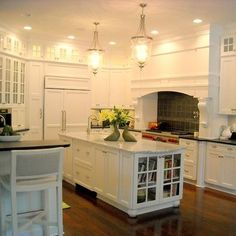 light kitchen cabinets and island, dark wood floors NY interior designer Jared Epps jaredshermanepps.com
