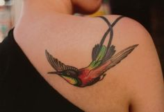 Very pretty hummingbird tattoo. Would be great for mastectomy scar coverage chest tattoo. [p-ink.org]