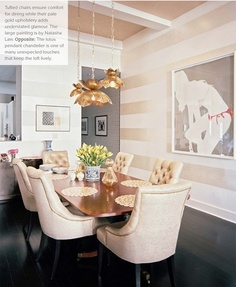 Metallic accent-striped wall with coordinating ceiling detail.