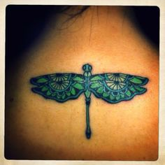 Dragonfly tattoo with a keyhole would be even better.