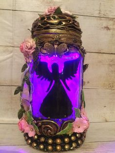 Excited to share this item from my #etsy shop: ANGEL JAR Handmade silhouette 8 inch beautiful angel jar . T Lights, String Lights, Fairy Jars, Power Colors, Pickle Jars, Color Changing Lights, Rose Quartz Crystal, Snow Globes, Bronze