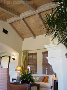 Untreated pecky cypress ceilings, all the warmth without the heaviness.