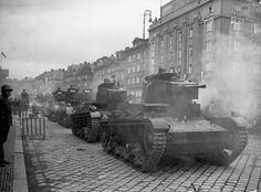 Column of Polish 7tp tanks moves through Cesin, Moravia, October, 1938. This town and its district was the subject of a complicated border dispute between the new states of Poland and Czechoslovakia following the collapse of the Austria-Hungarian Monarchy in 1918.