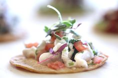 Our signature Tostadita de Ceviche appetizer features tangy red snapper on a crisp, fresh made shell. The combination is truly an exquisite summertime delight.   More info: https://www.sohotaco.com/2017/06/03/tangy-refreshing-tostadita-de-red-snapper-ceviche/