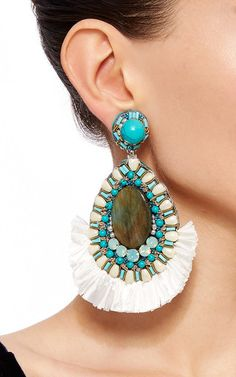 These **Ranjana Khan** earrings feature tear drop shape with labradorite at the center, turquoise and pearl detailing and raffia fringe trim.