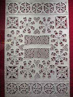 Hedebo is a form of openwork where a small patterned shape is constructed and then filled, using various buttonhole stitches to form pyramids, bars and other motifs. The patterned shape can be worked directly in a piece of fabric as an insertion, or constructed first and attached to a piece of fabric as an edge.