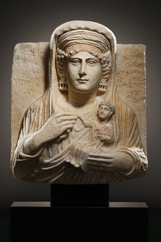 A FUNERARY RELIEF OF A LADY     56 cm. Limestone, red paint  Palmyra, 2nd half 2nd-1st half 3rd cent. A.D.