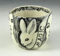 """This has so many of your favorite things, Alice in wonderland, white rabbit, """"tea"""" cup and a cat.  It's so Kelly.   Black and white porcelain tea bowl/ cup cat rabbit by PSPorcelain, $30.00"""