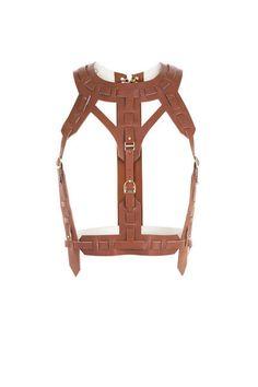 Hervé Léger Leather Harness Vest, $1,400; bcbg.com   - ELLE.com