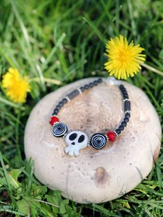 Haunted Mansion Holiday - Nightmare Before Christmas Inspired Bracelet - Sterling Silver, Ruby Quartz, Lava beads and Handmade Skull Charm. $25.00, via Etsy.