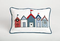 Beach House Cushion (infill included): Featuring a perfect row of beach houses, this embroidered cushion with solid piping evokes a warm-weather, playful charm. Rs. 1,910