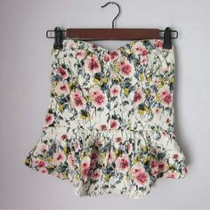 "Kimchi Blue strapless peplum floral top Gently worn. Great condition! No notable flaws. So cute for spring. Bustier style. Exterior 100% cotton. Length 13.5"". Armpit to armpit 15.5"".  Bundle for best deals! Hundreds of items available for discounted bundles! You can get lots of items for a low price and one shipping fee!  Follow on IG: @the.junk.drawer Kimchi Blue Tops Crop Tops"