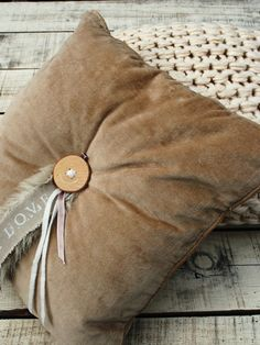 cute idea...add tags, ribbon, and what not to pillow and tack on with the button