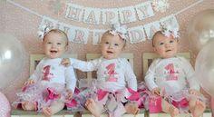 Rare identical triplets celebrate first birthday.