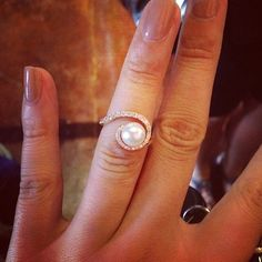 the prettiest pearl engagement ring. Love the swirl and rose gold brightens up the pearl. maybe in white gold too?