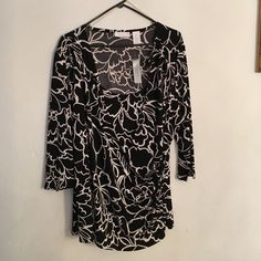 Faux wrap top Black and white floral print top. Three quarter length sleeves. Layering in the front with side rouched detail. Tags still attached. Never worn. Worthington Tops Blouses
