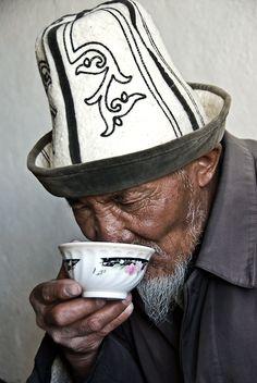 Kyrgyz man drinking tea, Karakul Lake, Tajikistan.