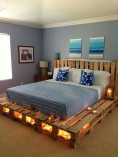 Wood pallets recycled into a playform bed and headboard. I love it! Would be perfect for a beach house