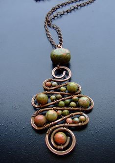 love this! beaded copper wire pendant w/ unikite gemstone beads
