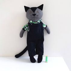 This cute cat named Mathias was relisted today. Reel of thread to show his size. ~~~~~~~~~~~~~~~~ #handmadedoll #dollmakers #saskiasstudio #coolcats #moderntoys #stuffeddoll #stuffedcat #giftforbaby #giftforboy #dungarees #ragdoll #dressupdoll #catdoll #stuffedcat #felixthecat