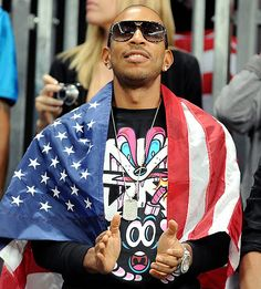 "Ludacris The ""Jingalin'"" rapper draped an American flag around his shoulders during the men's basketball preliminary round match between Argentina and the United States on August Proud Wife, Ludacris, Star Show, Men's Basketball, Celebs, Celebrities, My People, My Favorite Music, Olympic Games"