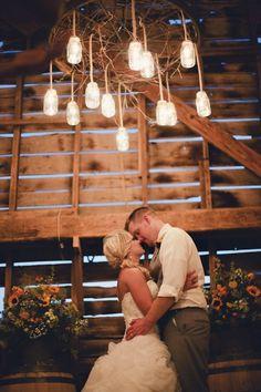 The groom built this mason jar chandelier!  {Rachel + Andrew's Summertime Barn Wedding}
