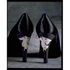 Pair of evening shoes in black silk satin with a Wedgwood heel.