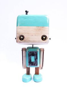Robot made of recycled wood green diabolo to metal parts