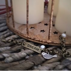 """{DREAM} ID Bracelet. Bracelet with engraved id tag """"DREAM"""" with bird and pearl charm. NWOT, received as a gift but I have too many similar items. No defects. Lobster claw closure. Can adjust to fit any wrist size. Was purchased from local boutique. Jewelry Bracelets"""