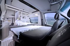 The very cool forward bench seat/bed in the Westfalia James Cook Sprinter motorhome Travel Camper, Camper Caravan, Diy Camper, Camper Life, Camper Van, Sprinter Motorhome, Mercedes Sprinter Camper, Mercedes Truck, Cargo Trailer Conversion