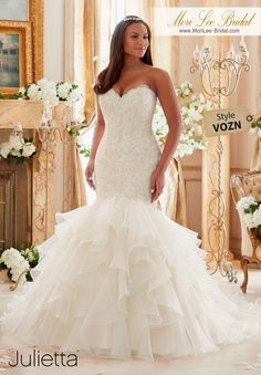 """Dress Style VOZN   CRYSTAL BEADED EMBROIDERED LACE MEETS FLOUNCED ORGANZA  Available in Three Lengths: 55"""", 58"""", 61"""".  Colors Available: White, Ivory, Ivory/Light Gold  #morilee #morileebridal"""