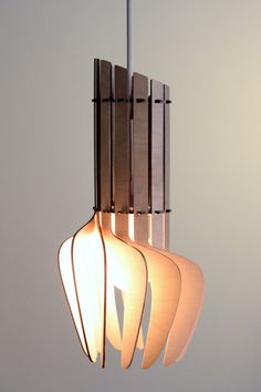 Tulipan Pendant Light by Tina Alnæs and William Kempton--Made from a single sheet of white PMMA or birch.