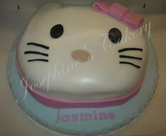 Hello Kitty cake.  Marbled pink and purple cake with toffee butter cream and fondant covering.