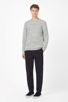 STRUCTURED KNIT JUMPER  Made from soft cotton with a tonal melange quality, this jumper has a tactile structured knit. Designed for everyday wear, it is a relaxed fit with long sleeves, a simple round neckline and comfortable ribbed edges.