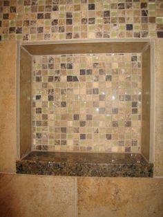 A sparkly tiled shower niche.