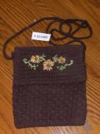 Price $10.00 Brown crochet with pretty peach flowers with green leafs. Small shoulder bag that was a promotional item. Front flap on bag lifts up to r...