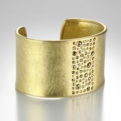 """An18k yellow gold cuff with natural colored rose cut diamonds = 5.01cttw and a raw diamond cube = 0.01ct. The cuff measures 1 1/2"""" wide."""