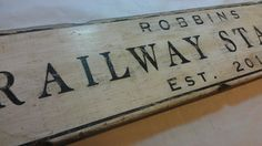 Custom Train Railway Station Wood Sign  All painted and distressed by hand in the USA Made to order, can be Personalized Made with Ponderosa Pine, 3/4 inch width Rustic vintage style wood sign Suitable for indoor and some outdoor conditions (see policies)  Custom Sizes Available! Only the smallest size ships outside the US!  These signs are hand crafted in Tennessee. You can have this sign customized anyway you like. You can choose the name of the station and color used. Alternatives could…