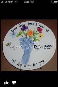 Footprint vase with fingerprint flowers