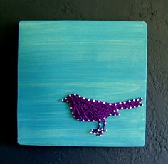 string art bird but make him in gray/silver string on the aqua bg