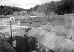 The HMS Quebec camp looking south, with the drill hall/cinema in the centre background. (1940s)