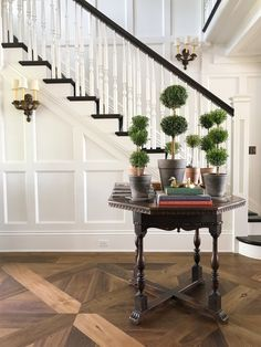 What a timeless foyer! is Walnut with an oil stain. is Benjamin Moore White Dove Entry Hallway, Entryway Tables, Benjamin Moore White, White Paint Colors, Stain Colors, Hill Interiors, Hardwood Floors, Flooring, Foyer Decorating