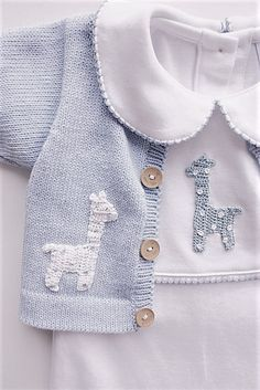 Let him cuddle up in this darling giraffe crochet playsuit! Made from Peruvian Pima Cotton and adorned with a beautiful hand-crocheted blue giraffe. *All N # classic childrens clothes Boy Giraffe Crochet Playsuit Baby Outfits, Kids Outfits, Pull Crochet, Hand Crochet, Free Crochet, Baby Knitting Patterns, Crochet Patterns, Giraffe Crochet, Giraffe Baby
