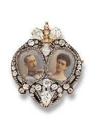 PROPERTY OF HRH PRINCESS ELIZABETH OF YUGOSLAVIA: A HISTORIC ROYAL PORTRAIT MINIATURE BROOCH, BY FRIEDRICH KOECHLI. The two miniature portraits of HRH Prince Nicholas of Greece and HI and HR Grand Duchess Elena Vladimirovna of Russia commemorating their wedding in 1902, within a rose-cut diamond border to the heart-shaped vari-cut diamond frame. Provenance: Her Imperial Highness Grand Duchess Elena Vladimirovna of Russia.